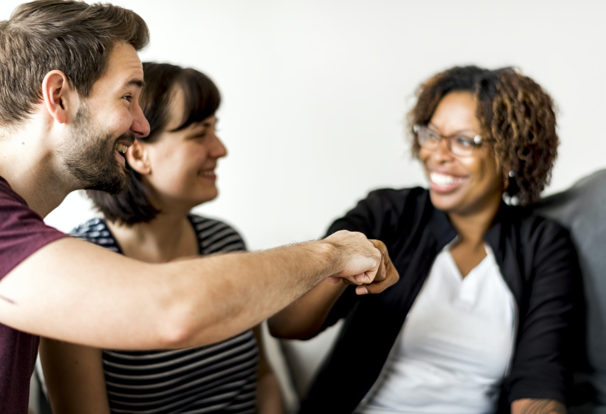 team members are happy because of effective conflict management