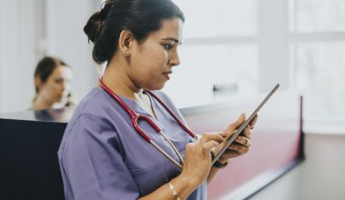 a nurse is looking at her work schedule