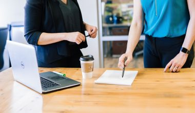 a manager is delegating tasks to staff