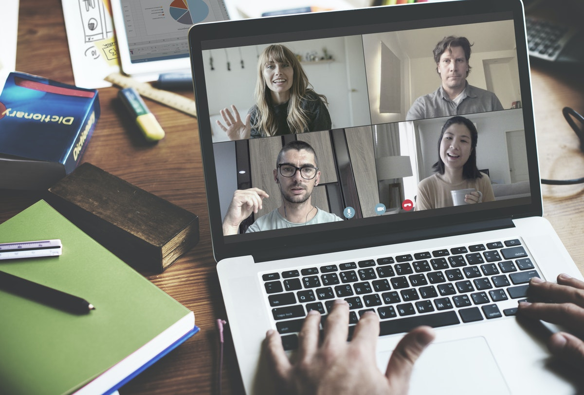 a team is participating in remote team building activities via computers