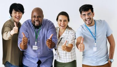 Different types of employees stand together